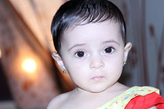 Arab baby girl with sunset Stock Images