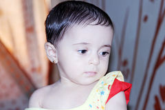 Arab baby girl with sunset Stock Photo