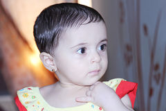 Arab baby girl with sunset Stock Photos