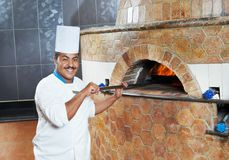 Arab baker chef making Pizza Stock Photo