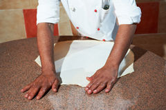 Arab baker chef making Pizza Royalty Free Stock Photo