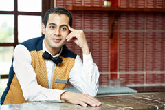 Cheerful arab barman Royalty Free Stock Photo