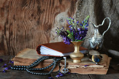 Arab book and flower. Old tattered book on a wooden table textural found an artifact of history Stock Images