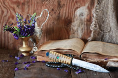 Arab book and flower. Old tattered book on a wooden table textural found an artifact of history Royalty Free Stock Photos