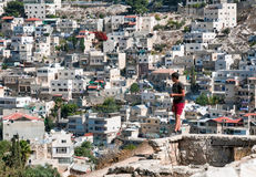 Arab boy on background quarter of Silwan in Jerusalem. Stock Photo
