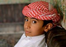 Arab boy with guhtra. Yemeni boy sitting Stock Images