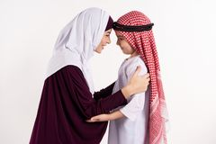 Arab boy and woman in hijab look royalty free stock image