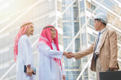 Arab Business handshake and business people on city background Stock Photos
