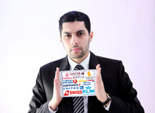 Arab business man with famous airlines and airways logos Royalty Free Stock Photo