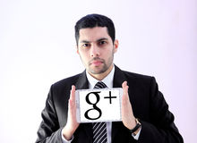 Arab business man with google plus logo Stock Photography