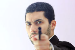 Arab business man with gun Royalty Free Stock Images