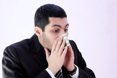 Arab business man has allergy and sneezing in money. Image of arab business man wearing black suit and sneezing in one dollar stock photography