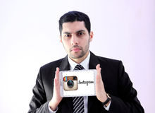 Arab business man with instagram logo Royalty Free Stock Photo