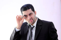 Arab business man looking through money Royalty Free Stock Photo