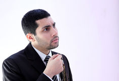 Arab business man praying for help. Image of arab business man wearing black suit and holding rosary asking god for help Royalty Free Stock Photography