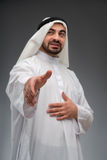 Arab business man stretching out his hand Royalty Free Stock Image