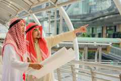 Arab Business people having consultation with city background. Royalty Free Stock Photography