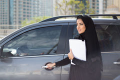 Arab Business Woman Standing next to a Car Stock Images