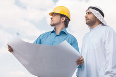 Arab businessman and builder. Royalty Free Stock Photo