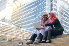 Arab Businessman and Businesswoman using computer Stock Photo