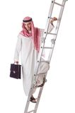Arab businessman climbing  stairs on white Stock Images