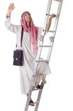 Arab businessman climbing  stairs on white Royalty Free Stock Photos