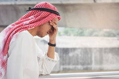 Arab Businessman is disappointed from losing in stock exchange, Royalty Free Stock Photos