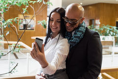 Arab businessman and girl making selfie Royalty Free Stock Images
