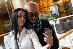 Arab businessman and girl making selfie Stock Photo