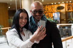 Arab businessman and girl making selfie Stock Photo