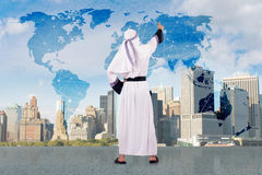 The arab businessman in global business concept. Arab businessman in global business concept Stock Photo