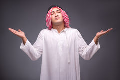 The arab businessman on gray background Royalty Free Stock Photography