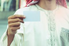 Arab Businessman hand showing business card.  Stock Images