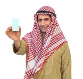 Arab Businessman hand showing business card isolated background. Arab Businessman hand showing business card isolated background with clipping path Royalty Free Stock Images