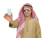 Arab Businessman hand showing business card isolated background. Arab Businessman hand showing business card isolated background with clipping path Stock Photography