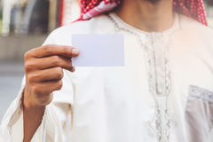 Arab Businessman hand showing business card Stock Images
