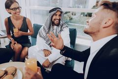 Arab Businessman Is Having Dinner With Partners.