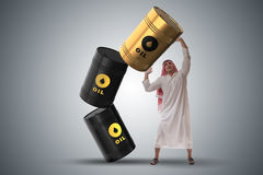 The arab businessman holding oil barrel Royalty Free Stock Image