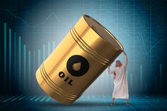 The arab businessman holding oil barrel Stock Images