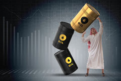The arab businessman holding oil barrel Stock Photo
