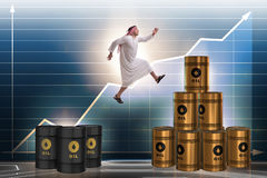 The arab businessman jumping from oil barrels Royalty Free Stock Images