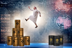 The arab businessman jumping from oil barrels Stock Image