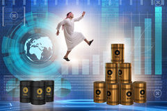 The arab businessman jumping from oil barrels Royalty Free Stock Photography