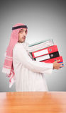 Arab businessman with many folders against Stock Photos