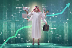 The arab businessman in multitasking concept Royalty Free Stock Photo