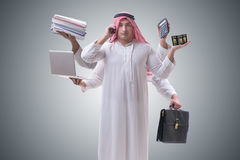 The arab businessman in multitasking concept Royalty Free Stock Photography