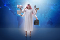 The arab businessman in multitasking concept. Arab businessman in multitasking concept Stock Photos