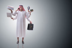 The arab businessman in multitasking concept Stock Images