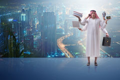 The arab businessman in multitasking concept Stock Photo