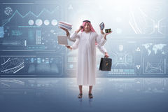 The arab businessman in multitasking concept Stock Photography